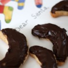 Almond Crescents III - Crescent shaped cookie with one half dipped in chocolate.