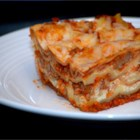 Easy Lasagna I - Mushrooms, onions and ground beef in a ready-made pasta sauce are layered with cottage cheese, ricotta cheese and Parmesan between uncooked lasagna noodles. Sprinkle mozzarella over the top and bake. It's that simple!