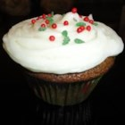 Gingerbread Cupcakes with Cream Cheese Frosting - A wonderful change of pace for the holiday season. Moist and spicy cake balanced by creamy, soft frosting.