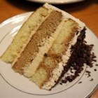 Tiramisu Layer Cake - Fancy taste without all the work.  This cake is wonderful for a get together or just a special occasion at home.  Using a box cake mix as a base it's a real time saver!