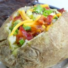 Baked Potato - A step by step recipe for making a baked potato. Serve with your choice of toppings. Try sour cream and chives, cheese, and olives.