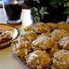 Persimmon Cookies - This is an old family recipe. We use the Hachiya variety of persimmons. This is a very spicy, very elegant holiday cookie. Pecans can be substituted for walnuts.