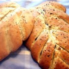 Fougasse - This recipe for fougasse, the French version of the Italian focaccia bread, is topped with mixed herbs.  The flat bread can be slashed to form shapes (a leaf, tree, or wheat stalk), or the slits can be cut to form a lattice, making the bread easy to pull apart.