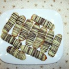 Pistachio Cream Cheese Fingers - These are tender and delicately flavored cookies - the light green color and chocolate drizzle make them stand out on a cookie tray.  Nice for holidays or bridal showers.
