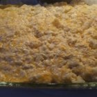 Potato Casserole I - Turkey or ham leftovers can be added to this one dish meal made with frozen hash browns.  The potatoes are combined with sour cream, onions, cheese, cream of mushroom and chicken soups and baked with a potato chip and bacon bit topping.