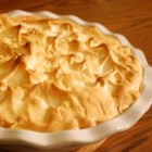Homemade Banana Pudding Pie - A homemade stovetop pudding is poured over a vanilla wafer crust and sliced bananas, topped with meringue, and baked. This recipe is old and authentic!