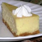 Eggnog Cheesecake III - A graham cracker crust is filled with a decadent mixture of cream cheese, sugar, eggnog and a hint of rum.  Garnish with whipped cream and colored sugar, if desired.