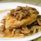 Paprika Chicken with Mushrooms - Chicken breasts, fresh mushrooms, and onions are cooked with butter to create a dish with vibrant color and delicate flavor.