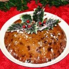 Steamed Christmas Pudding - Mincemeat is steamed with cranberry sauce, pumpkin puree, eggs, flour, butter and sugar, and served with a sweet, creamy frosting.