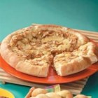 Brie Cheese Pizza - Layer Brie cheese and almonds on a pre-made pizza crust and bake for an impressive appetizer that takes just minutes to prepare.