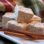 Creamy Eggnog Fudge - This eggnog-flavored fudge is made with real white chocolate, eggnog, nutmeg, and cinnamon. It's a very rich fudge worth every nibble!