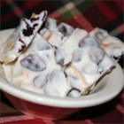 Cranberry Macadamia Nut Bark - This candy recipe is very pretty on gift trays and tasty too. If cranberries are not on hand, dried cherries or raisins will work beautifully in this recipe.