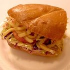 Pittsburgh Style Sandwich - A full meal; coleslaw, french fries, and all in between two slices of Italian bread! This unique sandwich recipe can be made with your favorite lunch meat.