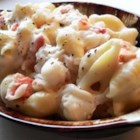 Lobster Mac and Cheese - High class meets down home. Fresh lobster and a blend of three cheeses are baked in a creamy lobster sauce in this dish. This is one of my favorites.