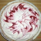 Raspberry Swirl - No-bake cheesecake type dessert with raspberries swirled through.