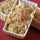 Chicken Noodle Casserole I - Comfort your tummy with this dreamy bake of chicken, cream of mushroom soup, cream of chicken soup, sour cream and tender egg noodles. Cracker crumbs sauteed in butter makes a deliciously crunchy topping.