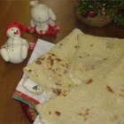 Christmas Lefse - This is a Norwegian-style lefse, that our family makes together every Christmas Eve morning.  The potato dough is refrigerated overnight to make the lefse more tender.  Delicious spread with butter and either white sugar or brown sugar!