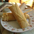 Beef Tamales - These are just like the tamales my Abuelita used to make for special occasions.  This recipe makes a lot, but if you're going to go to all the trouble of making tamales from scratch, you might as well have a party! You will need butchers' twine and a large pot with a steamer basket to make these. May be frozen up to 6 months in heavy-duty resealable plastic bags. To reheat, thaw in refrigerator and then steam or microwave until heated through.