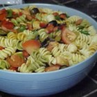 Salsa Pasta Salad - A zesty shake of vinegar, cilantro, garlic salt, lemon juice, oil and sugar dances with pasta tossed with onion, bell pepper, olives, tomatoes and green chilies. Let the salad chill for a while to bring out all the festive flavors.