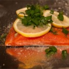 Garlic Salmon - A large salmon filet, steamed in foil and cooked either in the oven or barbecue.  It's seasoned with minced garlic, fresh baby dill, lemon slices, fresh ground pepper and green onions.