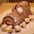 Buche de Noel - Buche de Noel is the French name for a Christmas cake shaped like a log. This one is a heavenly flourless chocolate cake rolled with chocolate whipped cream. Traditionally, Buche de Noel is decorated with confectioners' sugar to resemble snow on a Yule log.