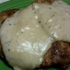 Country Fried Steaks with Sweet Onion Gravy - Country-fried cube steaks dredged in a spicy flour coating are pan-fried, then gently simmered in rich onion gravy until tender.