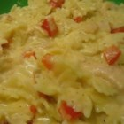 Cheesy Chicken Pepper Pasta - Tender strips of sauteed chicken and red bell peppers are bathed in a velvety sauce of milk, butter and Muenster cheese and served over linguine pasta. A dash of garlic powder adds just the right finish.