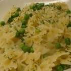 Pasta with Sweet Peas - To make a quick and easy meal, cook farfalle pasta in water flavored with chicken bouillon, then toss the hot pasta with  a bit of butter and some sweet green peas. Add a few red pepper flakes if you wish, and garnish with parsley to serve.