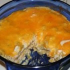 Southwestern Turkey Casserole - Use turkey leftovers to make this casserole baked with sour cream, green chilies, corn tortillas, cheddar cheese and canned cream of mushroom and chicken soups.