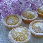 Lemon Butter Tarts - The filling for these diminutive treats is sweet and tart, with a delightful burst of grated lemon rind sweetness. The filling is spooned into 3-inch tart shells, covered with a dollop of meringue, and baked. This recipe yields a dozen.