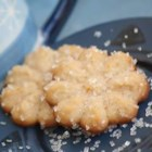 Butter Snow Flakes - A wonderful Spritz cookie with cinnamon in it. These freeze very well.