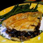 Easy Beef Pie - Sauteed stew meat is combined with red wine, canned vegetables, and canned beef gravy, then placed in a pastry shell and topped with a second pastry shell for baking.