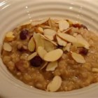 Rice and Raisin Breakfast Pudding - Who wouldn't want to eat a big bowl of this wonderful rice pudding-like hot cereal? Maple syrup, toasted almonds, raisins, cinnamon, and cardamom dress up leftover white or brown rice.