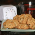 Oatmeal Drop Cookies - This recipe makes a big batch of cinnamon oatmeal raisin cookies. Chewy raisins and crunchy walnuts compliment the flavors.
