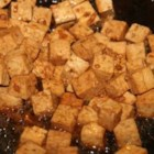 Garlic Ginger Tofu - Tofu simmered in its own juices and seasoned with garlic, fresh ginger, and a little lime juice - this pairs well with steamed rice and veggies to make an easy weeknight meal.