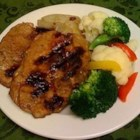 Honey Pork Fillets - Nice thick pork chops are butterflied and marinated in honey and Worcestershire sauce for four hours, and then they 're grilled. Serve with sweet potato salad and thick slices of fresh tomato.
