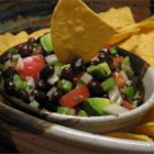 Texas Caviar with Avocado - Black-eyed peas, fresh avocado slices, and tomatoes highlight this spicy, flavor filled dip! Scoop it up by the chipful, and enjoy!