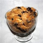Rice Pudding I - Baked rice pudding flavored with nutmeg and cinnamon and flecked with raisins.