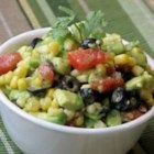 Avocado Salsa - Cool, refreshing avocado slices are mixed with a marinated corn, olives, red pepper and onion salsa. Serve this south of the border flavor explosion with tortilla chips.
