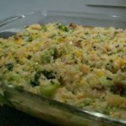 Family Casserole - Cooked chicken and rice get a makeover in this easy casserole made with broccoli, water chestnuts, mushrooms, and Cheddar cheese. This freezes wonderfully, too!