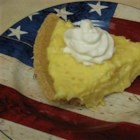 Lemon Pineapple Pie - Lemon pudding mix is combined with crushed pineapple and sour cream in this easy pie.