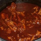 Chicken Mole - Browned chicken pieces simmer in a spicy tomato and chocolate sauce in this Mexican favorite.
