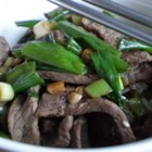 Authentic Korean Bulgogi - Thinly-sliced beef is flavored with a complex, sweet and salty marinade with pear juice, soy sauce, garlic, and sesame seeds, then grilled with optional mushrooms and onions for an authentic Korean dish.