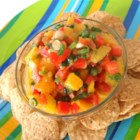 Nicole's Mango Salsa - This mango salsa featuring red bell pepper, jalapeno pepper, and green onions goes great with spicy seafood or as a dip for tortilla chips.