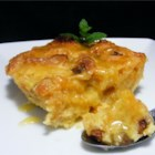Panettone Bread Pudding with Spiced Orange Sauce - This is a delicious variation on a classic made with the light and heavenly Italian Christmas bread. Panettone is similar to brioche but studded with raisins and candied orange and lemon peel. A luscious sauce made with orange liqueur, makes this dish perfect for the holidays. Serve as a dessert or a sweet and decadent breakfast.