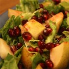 Pear and Pomegranate Salad - This colorful salad is a fall and winter favorite. It's garnished with pomegranate arils and dressed with a warm pomegranate vinaigrette.