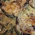 Pork Chops O'Brien with Creamy Gravy - Pork chops simmer with green beans and O'Brien potatoes in a creamy, sage-flavored sauce in this quick and easy weeknight recipe.