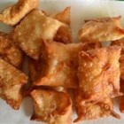Buffalo Wontons - Shredded chicken with buffalo sauce and cream cheese, wrapped up in a warm, crunchy wonton.