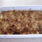 Posh Squash - Boiled squash is combined with eggs, Parmesan cheese, mayonnaise, onion and green pepper and baked with a bread crumb topping in this casserole serving six.