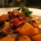 Brazilian Black Bean Stew - Sweet potatoes, mango, black beans, and cilantro are featured in this flavorful stew from South America.